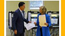 Republican presidential nominee Mitt Romney and his wife, Ann, finish filling out their ballots while voting during the U.S. presidential election in Belmont, Massachusetts. (BRIAN SNYDER/REUTERS)