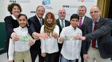 Beth Butcher, Toronto District School Board Superintendent of Education, left rear, Jacques Ménard, chairman of BMO Nesbitt Burns and vice-chair of the Task Force on Financial Literacy, Gary Rabbior, CFEE president, Ted Menzies, Minister of State (Finance), and Matthew Reid, Principal of Sprucecourt Public School, pose with students as they kick off the 'Talk with our kids about money day' program Thursday in Toronto. (STEPHANIE LAKE/MARKETWIRE)