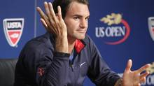 Switzerland's Roger Federer answers questions at a news conference ahead of the 2012 U.S. Open tennis tournament in New York August 25, 2012. (EDUARDO MUNOZ/REUTERS)