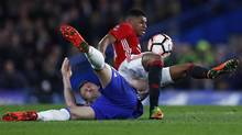 Chelsea's Gary Cahill, left, and Manchester United's Marcus Rashford collide during Monday's FA Cup quarter-final in London. (Eddie Keogh/REUTERS)