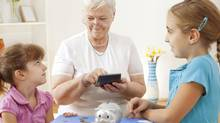 If you've maxed out your RRSPs and carry little debt, your grandchildren might appreciate some help with their education. (iStockphoto)