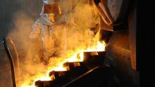 A refiner pours bars of gold at Agnico-Eagle's Meadowbank mine facility in Meadowbank Mine, Nunavut, in this file photo. Statscan says business investment will edge higher this year but a reluctance by mining companies to spend will weigh on overall gains. (Sean Kilpatrick/The Canadian Press)