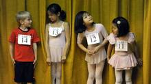 Young ballet dancers Daniel Chauvin, Renee Ng, Bridgette Ng and Natalie Ng stand together as boys and girls ages 6 to 10 try out for The School of American Ballet. (TIMOTHY A. CLARY/AFP/Getty Images)