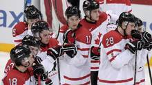 Canada's world junior squad of under-20s struggled throughout the tournament with discipline on the ice, taking nine penalties in the quarter-final loss to Finland. (MARKKU ULANDER/AFP/Getty Images)