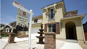 A newly sold home at a new housing subdivision is seen in San Marcos, California on Aug. 20, 2007. The economic contagion that started with a slump in U.S. home prices has spread throughout the financial sector due to default rates on risky subprime mortgages.