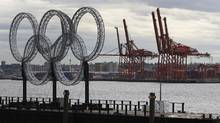The Olympic rings sit on a barge in the foreground as cranes in the loading area at the Port of Vancouver sit idle March 16, 2010. (Jeff Vinnick For The Globe and Mail/Jeff Vinnick For The Globe and Mail)