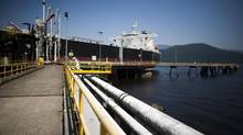 Various pipes including crude oil pipeline leading from Alberta is seen far right as the a an oil tanker arrives at the Kinder Morgan Westridge marine terminal in Burnaby, B.C. in this photo from July 8, 2012. (Rafal Gerszak For The Globe and Mail)