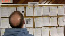 A job seeker looks at listings in an employment centre in London, Ont. (DEBORAH BAIC/THE GLOBE AND MAIL)