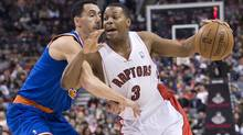 Kyle Lowry will play with a splint on his left ring finger for about six weeks after suffering an injury to the tendon last Wednesday. (NATHAN DENETTE/THE CANADIAN PRESS)