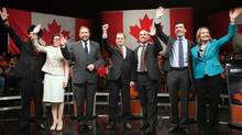 NDP leadership candidates Martin Singh, Niki Ashton, Thomas Mulcair, Brian Topp, Nathan Cullen, Paul Dewar and Peggy Nash wave to the crowd during the NDP leadership debate in Vancouver on March 11, 2012. (REUTERS)