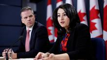 Canada's Democratic Institutions Minister Maryam Monsef speaks during a news conference with Liberal MP Mark Holland in Ottawa on Thursday. (Chris Wattie/Reuters)