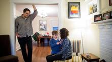 Toronto residents Andy Stark, left, and Sylvia Proano with one of their two children. (Tim Fraser/The Globe and Mail)