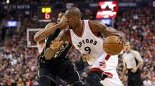 Toronto Raptors forward Serge Ibaka sat out practice Monday with a sprained ankle. (John E. Sokolowski/USA Today Sports)
