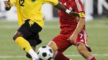 Jamaica's Demar Phillips battles for the ball with Canada's Paul Stalteri (R) during the first half of their 2010 FIFA World Cup Qualifiers soccer match in Toronto August 20, 2008. (MARK BLINCH/REUTERS)