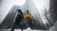 A pedestrian walks past the head offices of Laurentian Bank in Montreal, March 19, 2013. (CHRISTINNE MUSCHI/REUTERS)