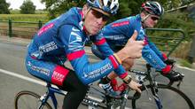 Lance Armstrong and Floyd Landis ride together doing a practice session in Luz-Ardiden in this July 22, 2003 file photo. (ERIC GAILLARD/REUTERS)