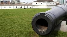Canada Goose walks by a canon on display at Fort York in Toronto on March 23, 2012. (Michelle Siu For The Globe and Mail)