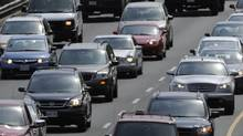 Commuters slowly make their way out of Toronto as they drive north on the Don Valley Parkway (Fred Lum/The Globe and Mail)