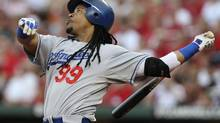 Though he hasn't played for the Dodgers since 2010, Los Angeles is still on the hook for Manny Ramirez. (PETER NEWCOMB/REUTERS)