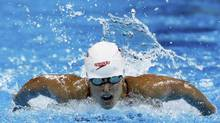 Canada's Katerine Savard competes in the women's 200m butterfly heats at the 14th FINA World Championships in Shanghai July 27, 2011. Savard won a silver medal at the second stop on Europe's Mare Nostrum circuit. (DAVID GRAY/REUTERS)