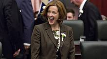 Alberta Premier Alison Redford reacts to seeing members of the legislative assembly before the Throne Speech at the Alberta Legislature in Edmonton on March 3, 2014. (JASON FRANSON/THE CANADIAN PRESS)