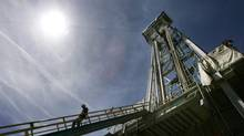 A worker steps down from a drilling platform at a geothermal project near LaPine, Ore. A lack of government policy support is blamed for keeping the industry from getting started here. (Don Ryan/The Associated Press)