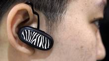 An attendee at the Consumer Electronics Show in Las Vegas tests a Bluetooth device. (Paul Sakuma/AP)