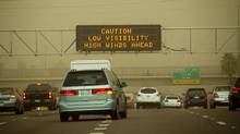 A sign warns motorists of low visibility and high winds conditions Monday, July 18, 2011 along Interstate 10 in Phoenix. (AP Photo / The Arizona Republic / Michael Schennum/AP Photo / The Arizona Republic / Michael Schennum)