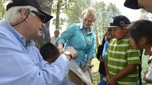 Ruth Ann Onley, centre, and former Ontario lieutenant-governor James Bartleman attend the Lieutenant-Governor's Summer Aboriginal Reading Camp at the Eabametoong First Nation on July 17, 2013. (Fred Lum/The Globe and Mail)