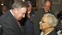 Nova Scotia Premier Darrell Dexter greets Wanda Robson in New Glasgow, N.S., on Thursday, April 15. Ms. Robson's sister Viola Desmond was posthumously pardoned for her 1946 arrest. (PAUL DARROW/Paul Darrow/Reuters)