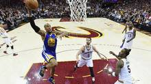 David West of the Golden State Warriors goes up with the ball against Kevin Love and J.R. Smith of the Cleveland Cavaliers in Game 3 of the NBA finals on June 7, 2017. (Kyle Terada/Pool/Getty Images)