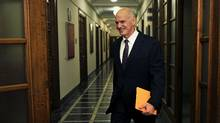 Greek Prime Minister George Papandreou arrives for a cabinet meeting in Athens on Tuesday. (Louisa Gouliamaki/AFP/Getty Images)