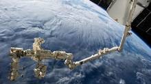 The Canadarm, a testament to Canada's robotics and engineering capability, operates in Earth's orbit. (NASA)