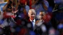 U.S. President Barack Obama, right, and Vice-President Joe Biden wave at the end of the final session of the Democratic National Convention in Charlotte, N.C., on Sept. 6, 2012. (Chris Keane/REUTERS)