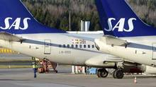 SAS, half-owned by the governments of Sweden, Denmark and Norway, said eight unions had backed wage cuts and changes to working schedules and pensions (Johan Nilsson/Reuters)