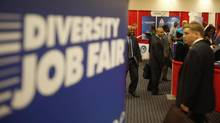 Attendees carry their resumes as they arrive at a job fair in a Washington hotel in this file photo. (JASON REED/REUTERS)