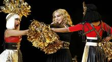 Madonna performs during the halftime show with Nicki Minaj (L) and M.I.A. in the NFL Super Bowl XLVI football game in Indianapolis, Indiana, February 5, 2012. (MIKE SEGAR/Mike Segar/Reuters)