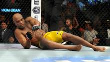 Anderson Silva gets from the canvas after Chris Weidman won their UFC 162 mixed martial arts middleweight championship bout by a TKO at the MGM Grand Garden Arena on Saturday, July 6, 2013, in Las Vegas. (David Becker/AP)