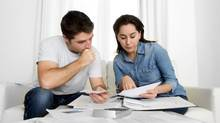To pay down debt, Canadian couples in their 30s need a strategic long-range plan. They also need to be realistic. (Getty Images/iStockphoto)