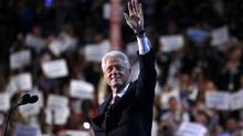 Former U.S. President Bill Clinton waves as he arrives to address the second session of the Democratic National Convention in Charlotte, North Carolina, September 5, 2012. (Jessica Rinaldi/REUTERS)