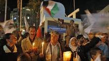 Palestinians hold candles during a rally in the West Bank city of Ramallah, in support of president Mahmoud Abbas's bid for statehood recognition at the United Nations, on Sept. 20, 2011. (MOHAMAD TOROKMAN/REUTERS)