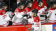 Team Canada's Taylor Hall celebrates his goal with his teammates during the second period of their world junior pre-competition against Finland in Calgary. (TODD KOROL)
