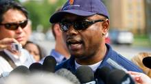 CEO and President of the Toronto Community Housing Corporation Gene Jones addressed the media the morning after a shooting at a backyard barbecue on Danzig St. in July, 2012. (Galit Rodan/The Globe and Mail)