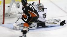 Anaheim Ducks right wing Devante Smith-Pelly, left, scores past Los Angeles Kings goalie Jonathan Quick during the second period in Game 5 of an NHL hockey second-round Stanley Cup playoff series in Anaheim, Calif., Monday, May 12, 2014. (Chris Carlson/AP)