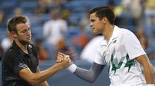 Milos Raonic (R) shakes hands with Jack Sock (L) after their match on day three of the Citi Open tennis tournament at Fitzgerald Tennis Center. Raonic won 7-6, 7-6. (Geoff Burke/USA Today Sports)