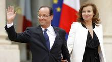 France's new President Francois Hollande and his companion Valerie Trierweiler leave the Elysee Palace after Mr. Hollande took power in Paris, May 15, 2012. (Benoit Tessier/Reuters/Benoit Tessier/Reuters)