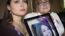 Danielle Raymond, left, and her mom Julie hold a photo of Shannon, who died after taking ecstasy on a B.C. party bus in 2008. They are shown at their home in Maple Ridge, Feb. 26, 2013. (John Lehmann/The Globe and Mail)