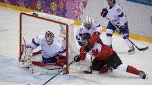 Team Canada's Corey Perry tries to wrap the puck around the nest in a game against Team Norway during the first period of Olympic Ice hockey action at the Sochi Winter Olympics February 13, 2014. (John Lehmann/The Globe and Mail)