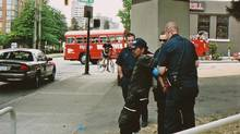 A handout photo of a shelter resident being arrested by police in Vancouver in June 2009. (Jeff Vinnick For The Globe and Mail)