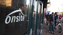 People wait outside Onsite, a twelve-bed detox unit located next to Insite supervised injection site run by the Portland Hotel Society, in the Downtown Eastside in Vancouver, British Columbia, Thursday, November 21, 2013. (Rafal Gerszak/Globe and Mail)